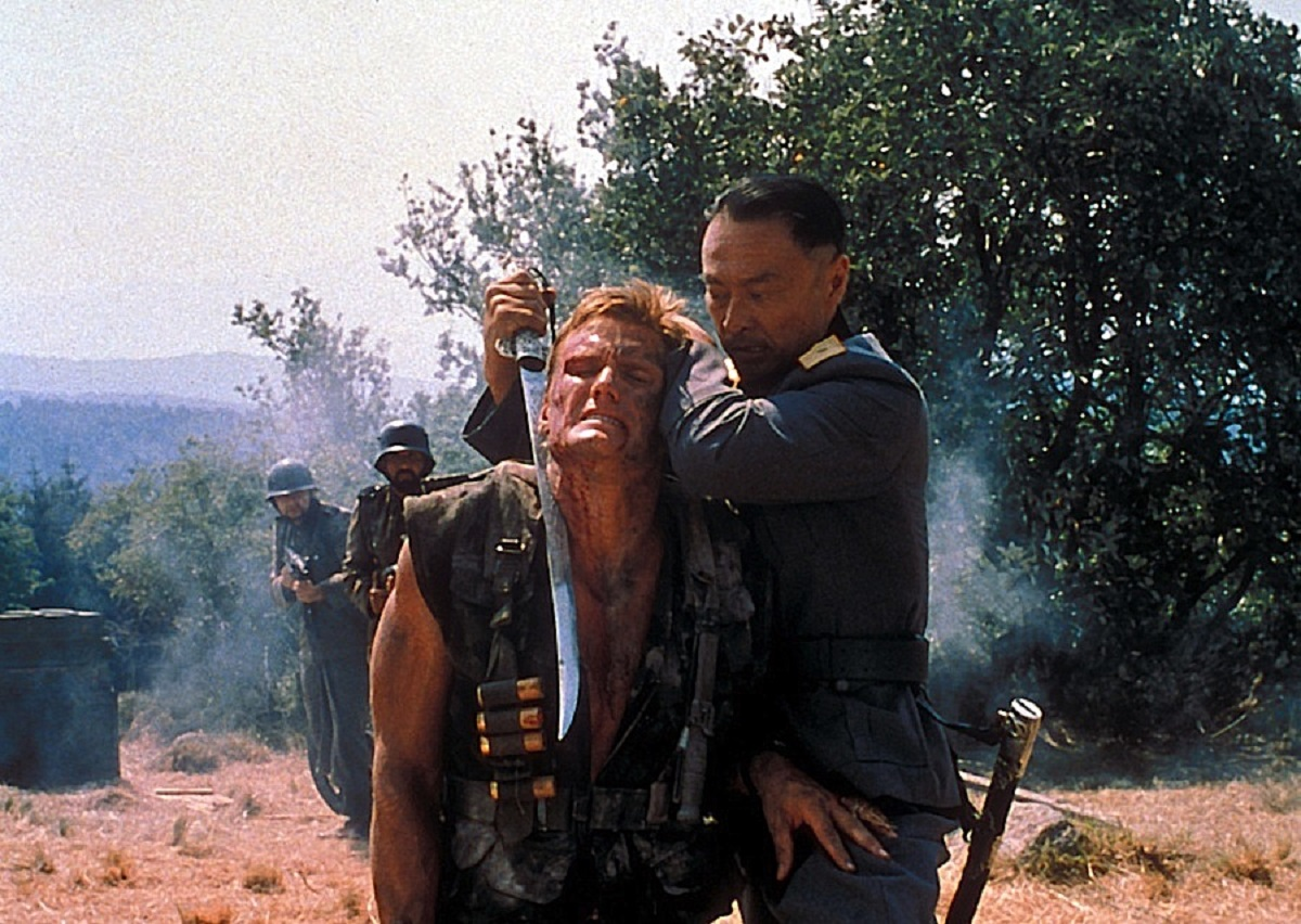 (l to r) Warchild (Dolph Lundgren) is threatened by General Ruechang (Cary-Hiroyuki Tagawa) in Bridge of Dragons (1999)