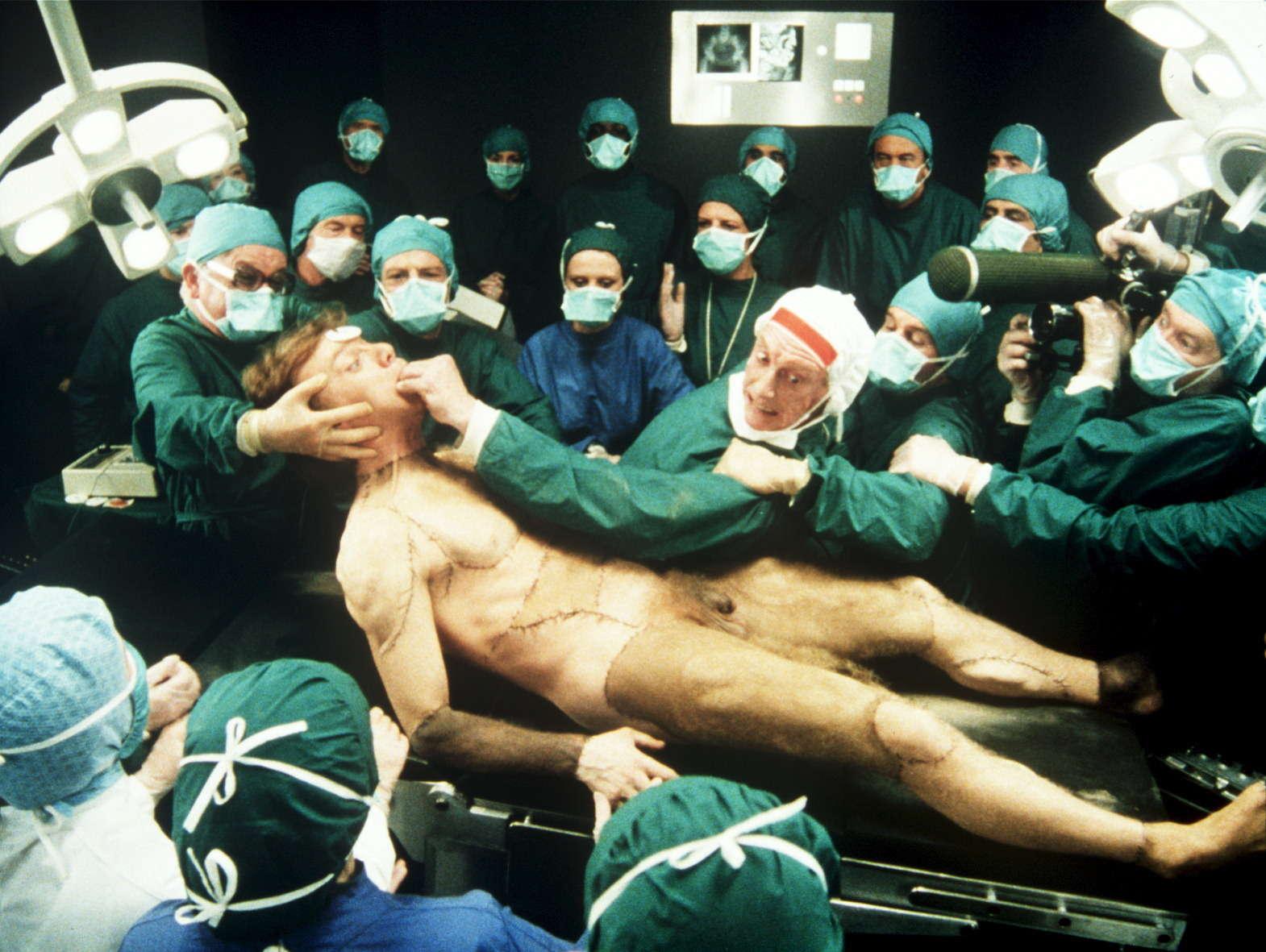 Professor Millar (Graham Crowden) unveils his Frankenstein creation (Malcolm McDowell) in Britannia Hospital (1982)