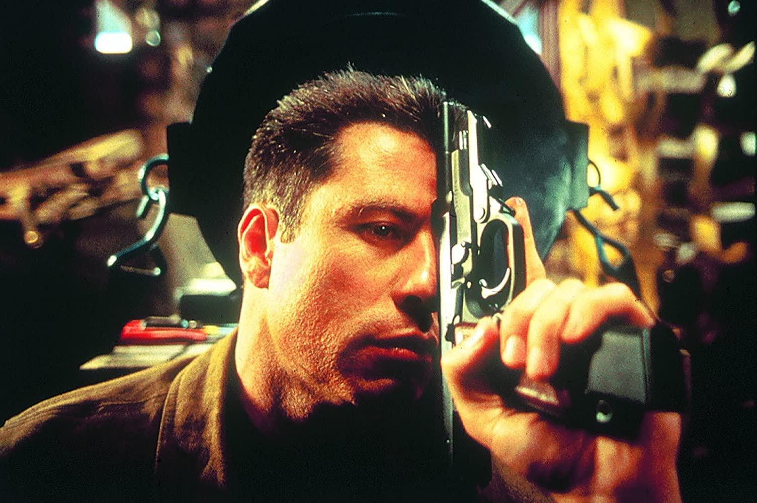 John Travolta as Major Vic Deakins in Broken Arrow (1995)