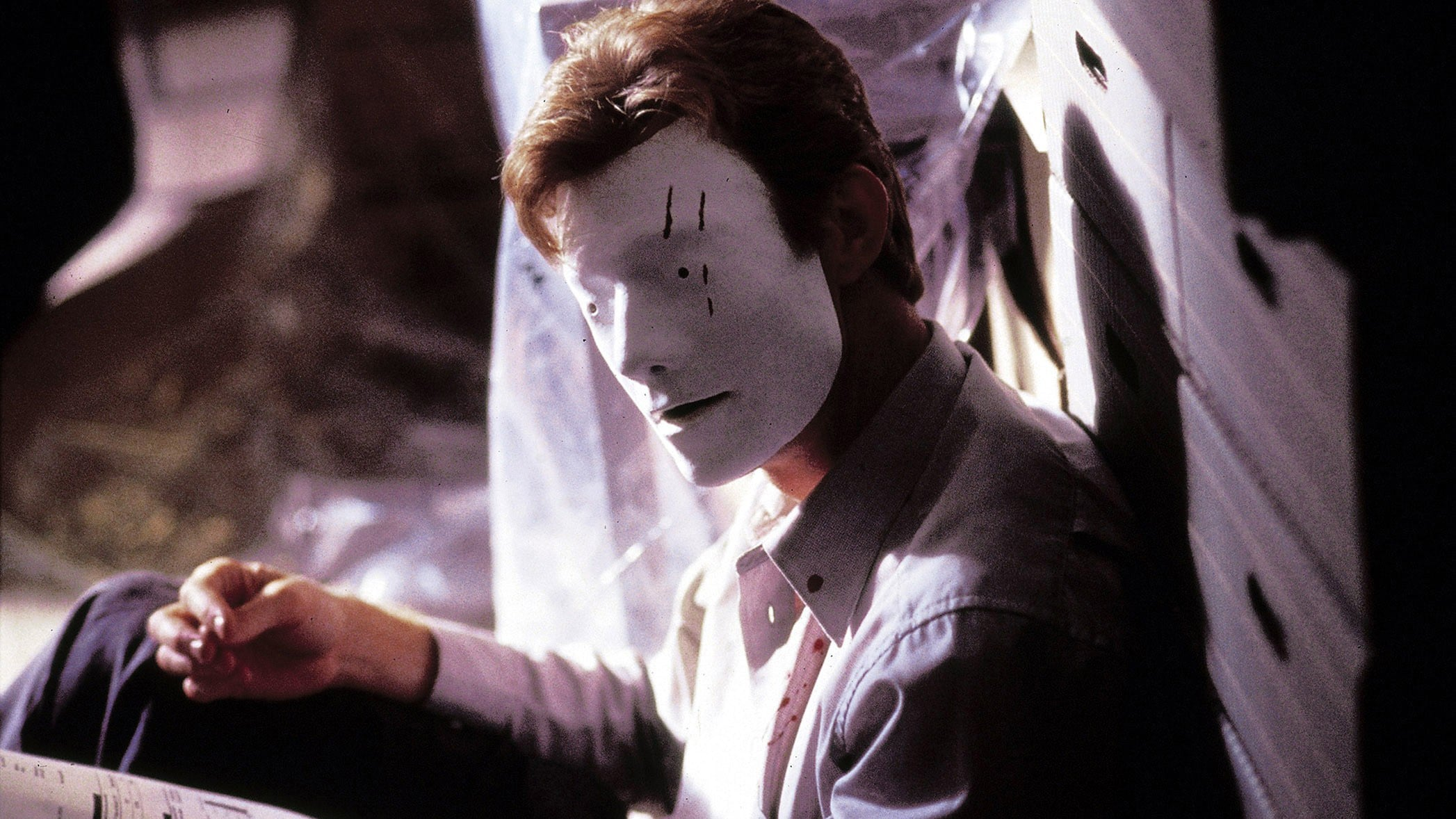 Jason Flemyng wakes up wearing a blank white face mask in Bruiser (2000)