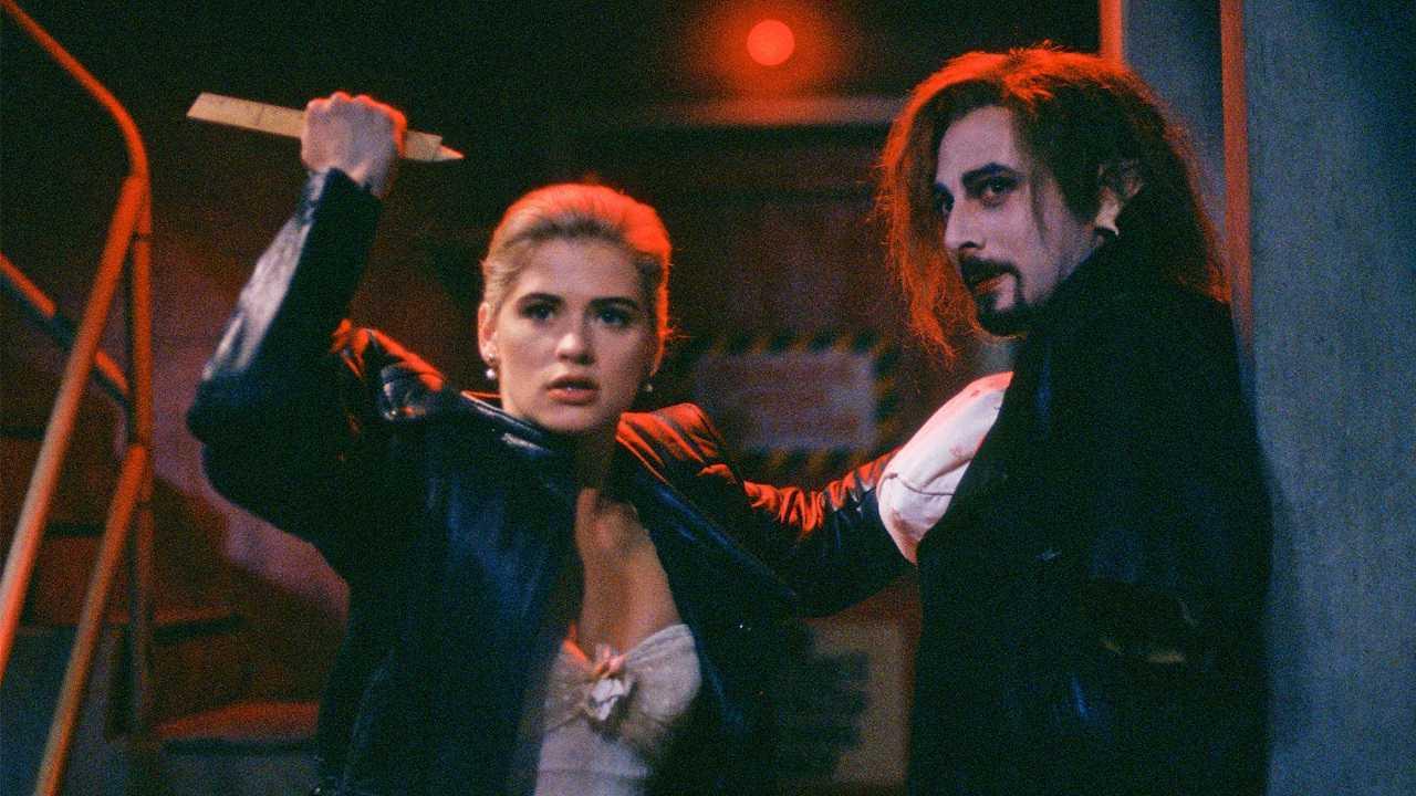 Buffy (Kristy Swanson) prepares to stake vampire Paul Reubens in Buffy the Vampire Slayer (1992)