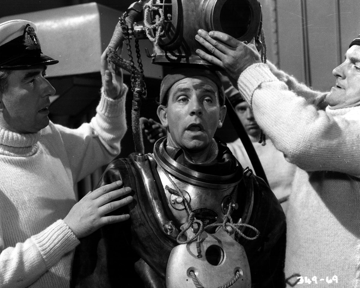 Norman Wisdom placed in a diving suit in The Bulldog Breed (1960)