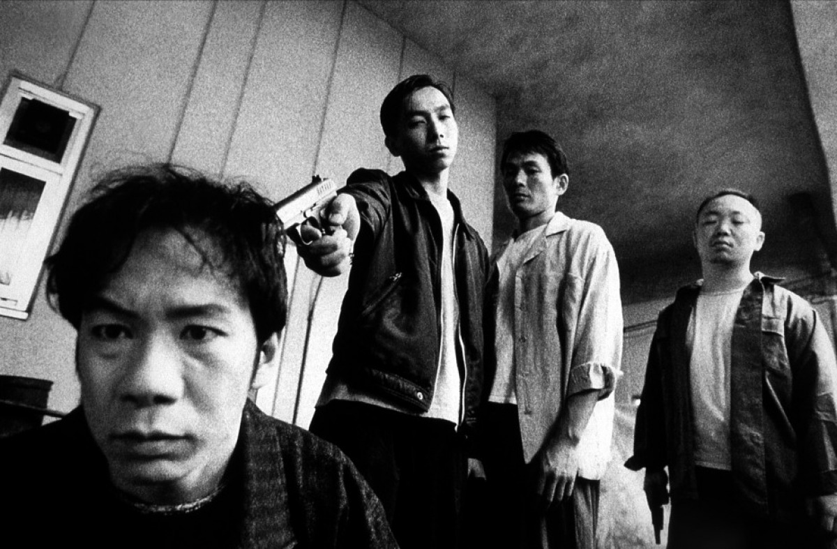 Goda (played by director Shinya Tsukamoto) taunted by gangland members in Bullet Ballet (1998)