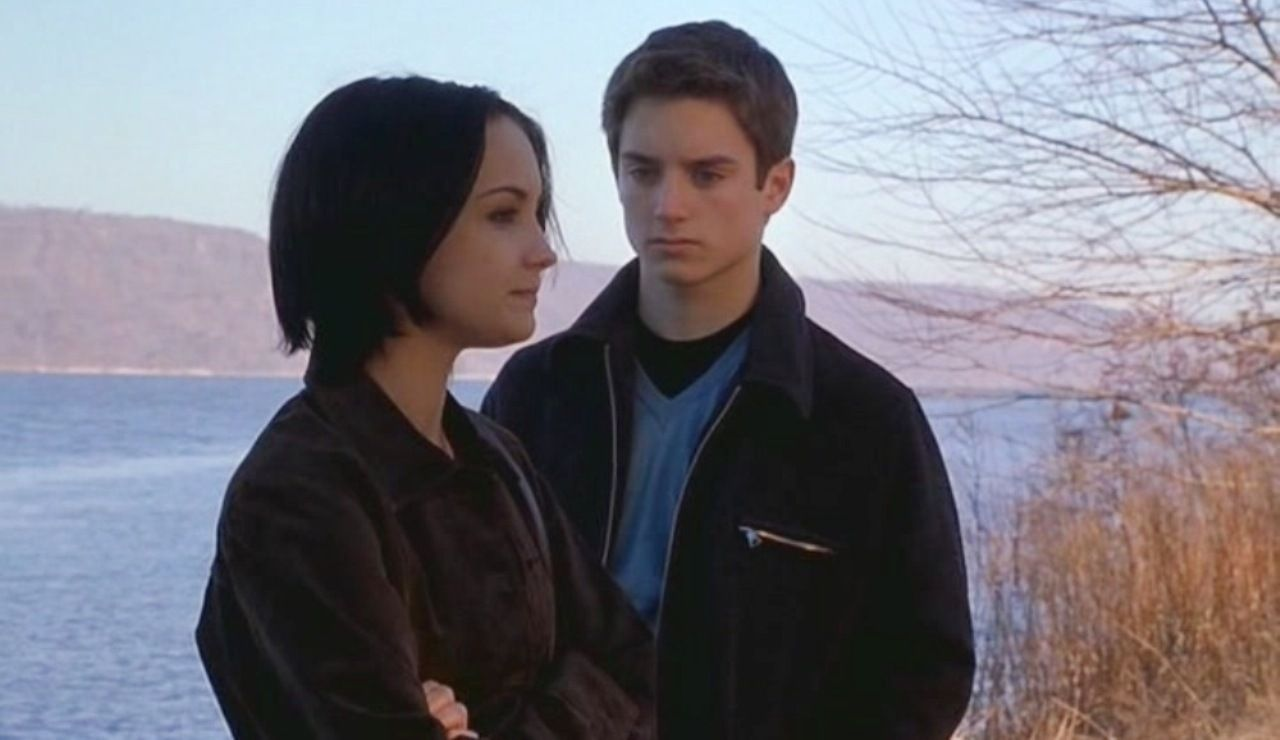 Rachael Leigh Cook and Elijah Wood in The Bumblebee Flies Anyway (1999)