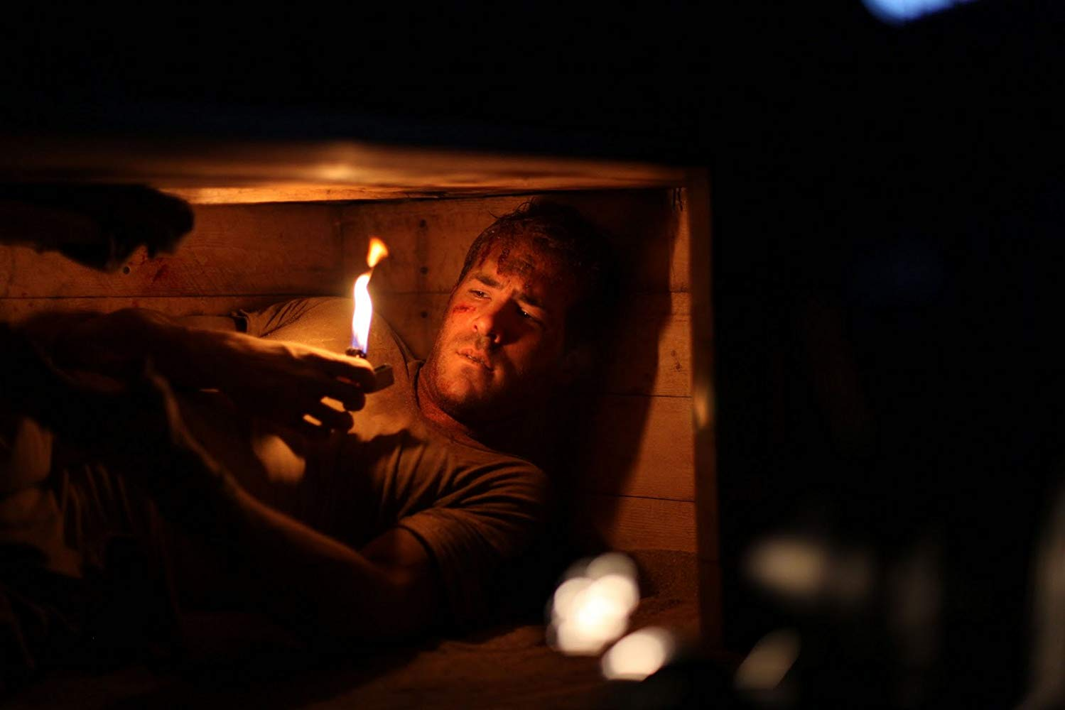 Ryan Reynolds trapped in a coffin in Buried (2010
