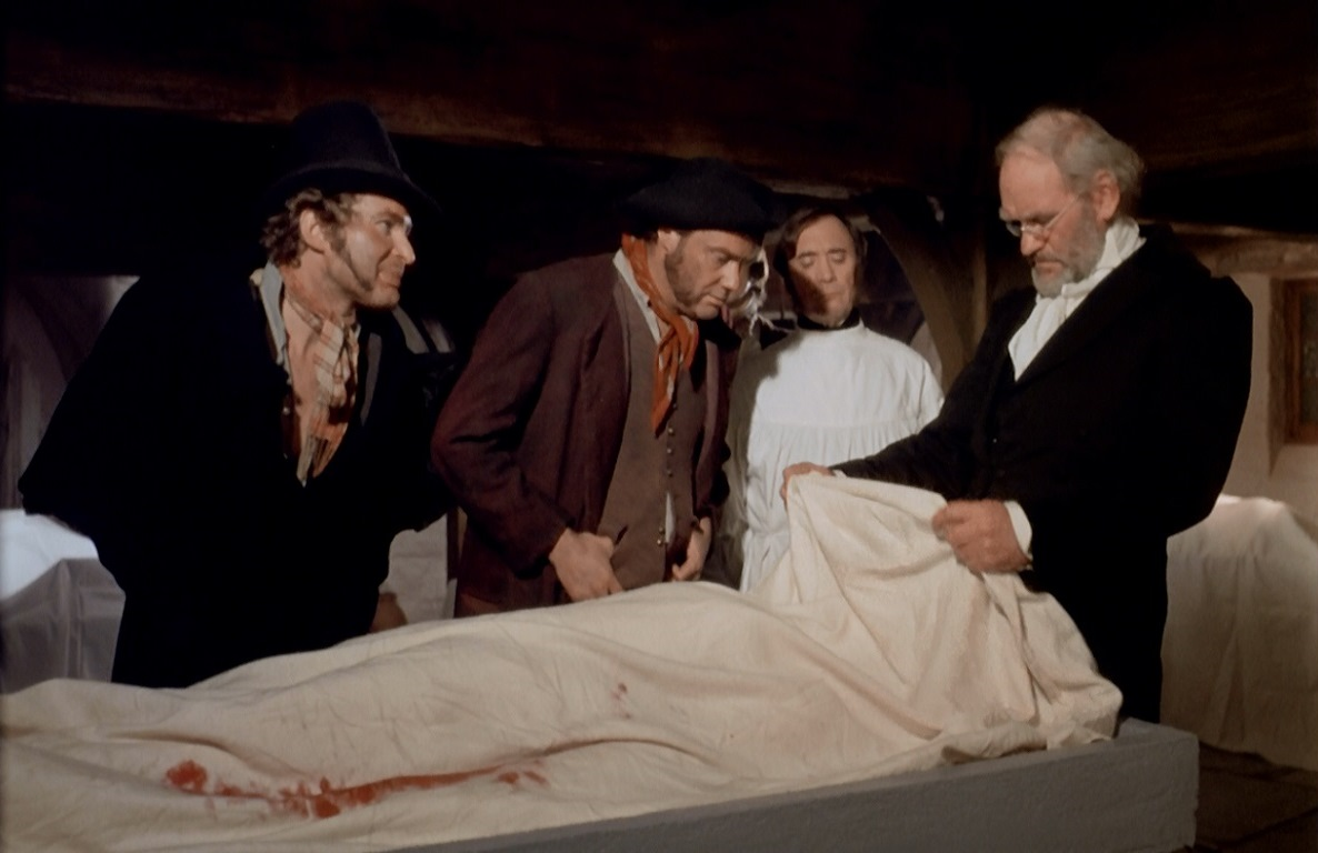 (l to r) Burke (Derren Nesbitt) and Hare (Glynn Edwards) deliver a cadaver to Dr Knox (Harry Andrews) (r) in Burke & Hare (1972)