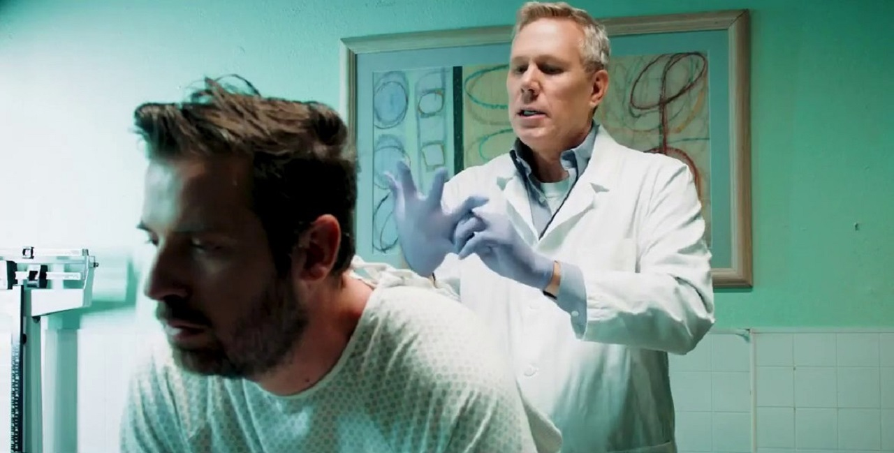Chip Gutchell (Tyler Cornack) receives a rectal examination from his doctor in Butt Boy (2019)