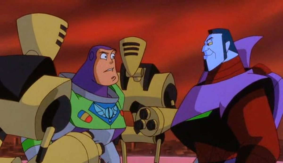 Buzz Lightyear (voiced by Tim Allen) captured by Emperor Zurg (voiced by Wayne Knight) in Buzz Lightyear of Star Command: The Adventure Begins (2000)