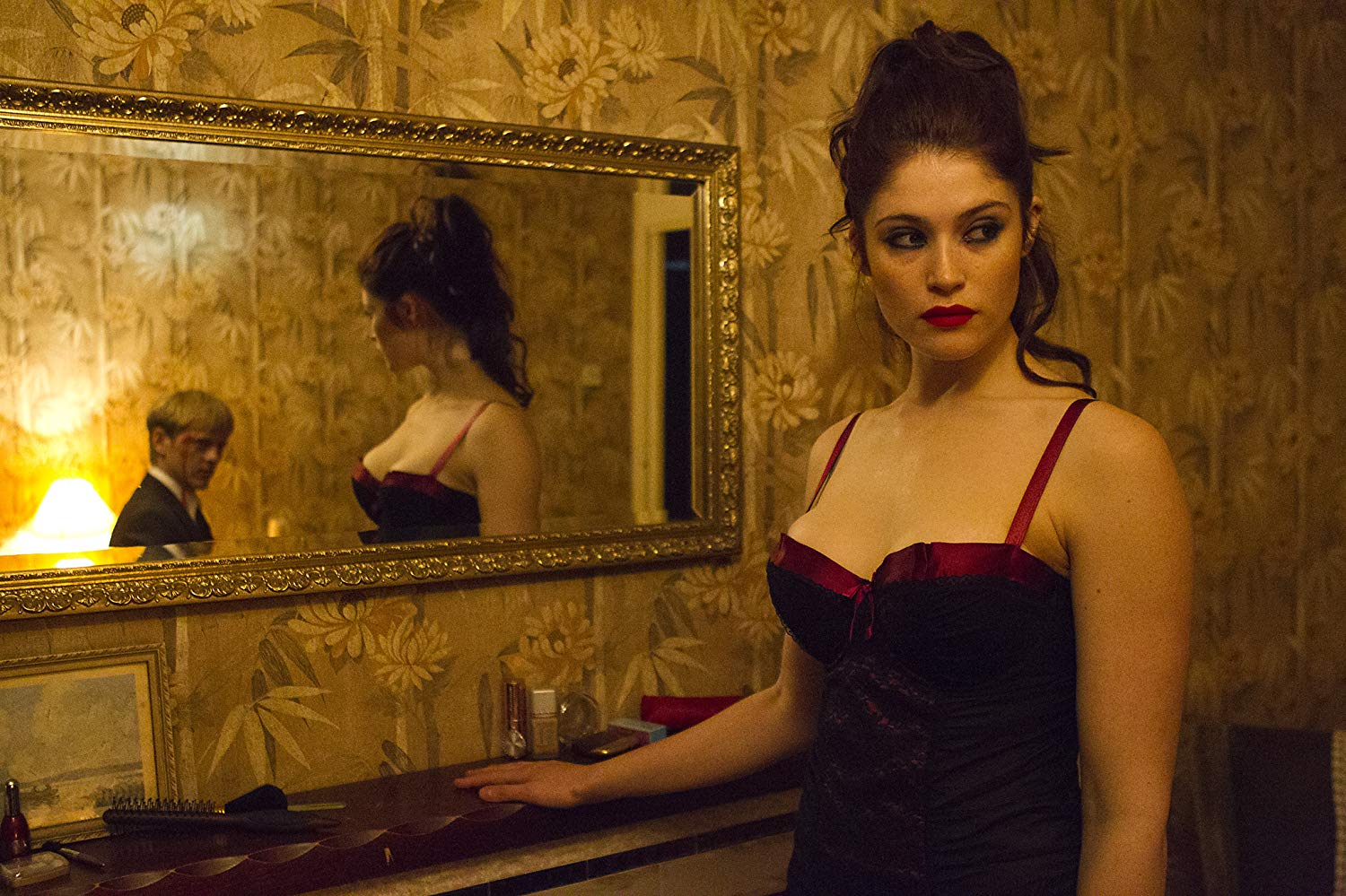 Clara (Gemma Arterton) lures Thure Lindhardt (reflected in mirror) to her apartment in Byzantium (2012)