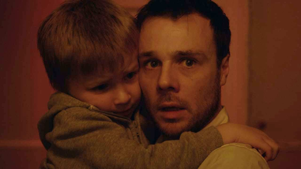A haunted Rupert Evans and his young son Calum Heath in The Canal (2014)