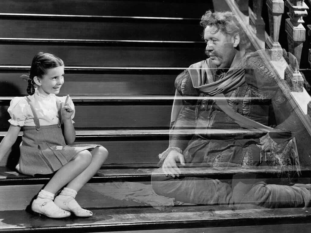 Charles Laughton as the ghostly Sir Simon de Canterville with young Margaret O'Brien in The Canterville Ghost (1944)