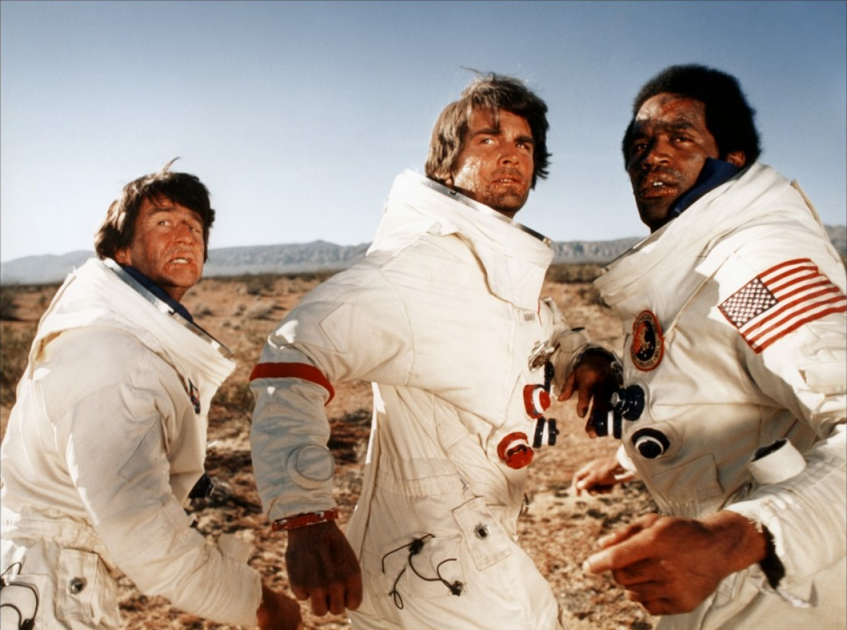 The astronauts - (l to r) Sam Waterston, James Brolin and O.J. Simpson - escape into the desert in Capricorn One (1978)