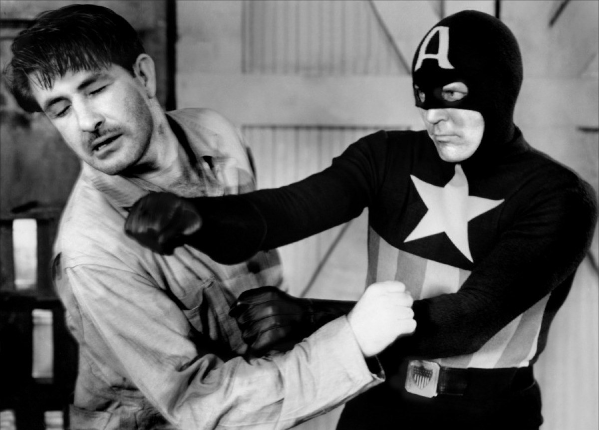 Captain America (Dick Purcell) sorts out an evildoer in Captain America (1944)
