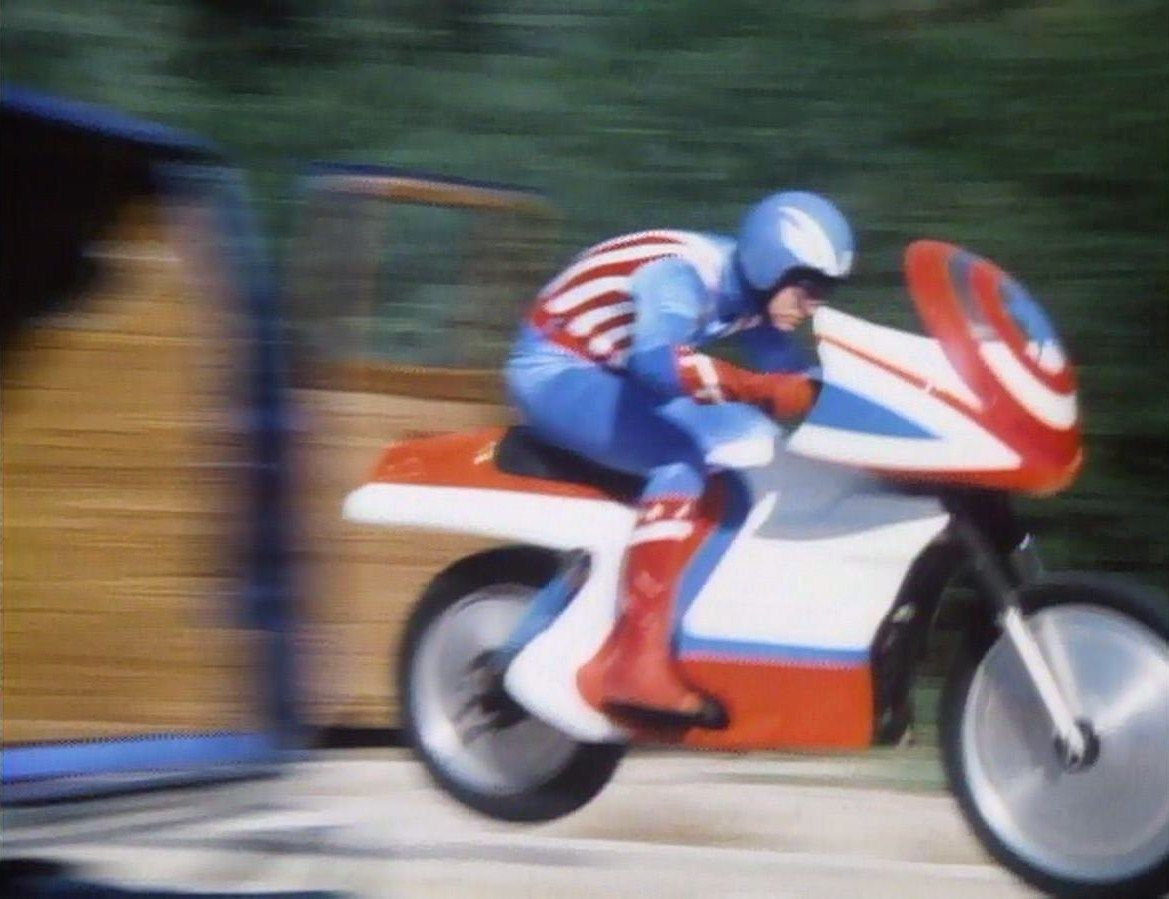 Captain America (Reb Brown) goes into action aboard his motorcycle