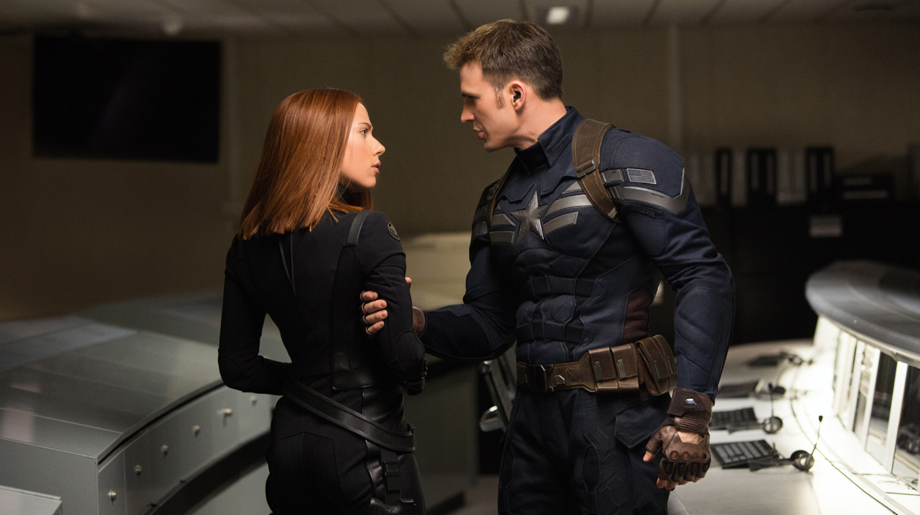 Captain America (Chris Evans) has a quiet word with Black Widow (Scarlett Johansson) in Captain America: The Winter Soldier (2014)