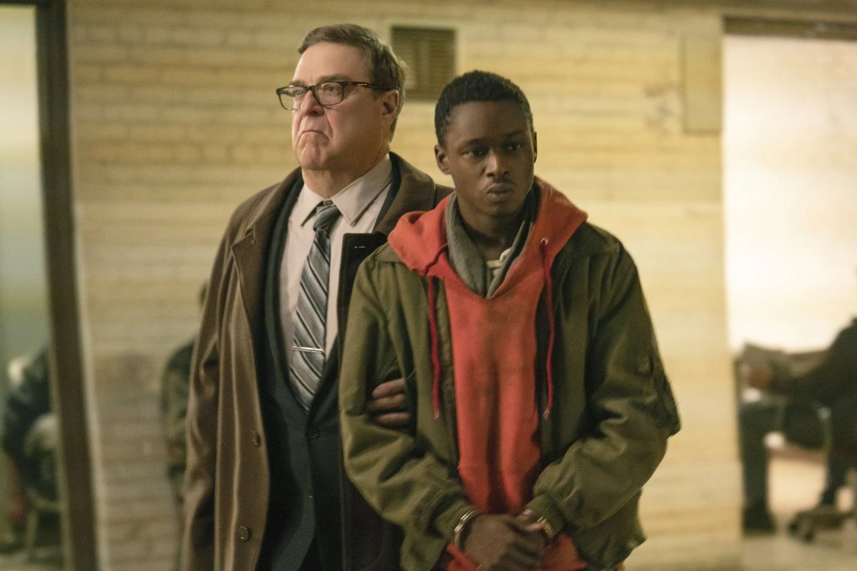 (l to r) District police commander John Goodman and teenager Ashton Sanders drawn into involvement with the resistance in Captive State (2019)