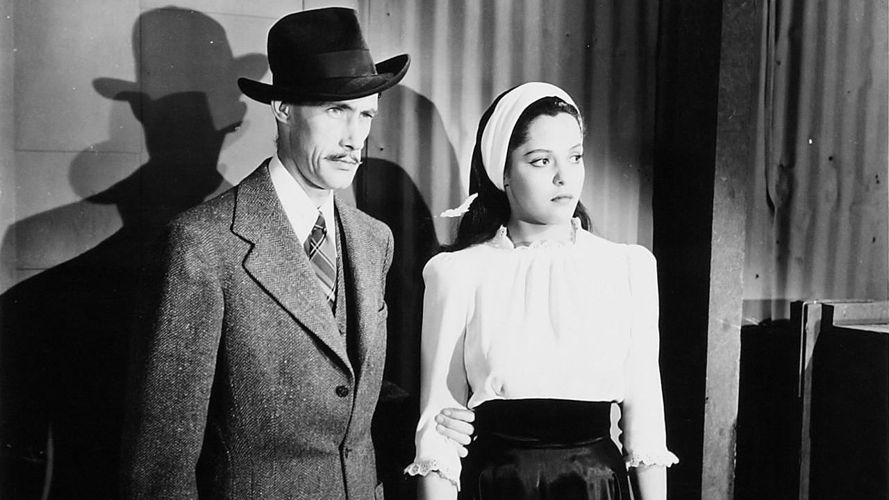 Mad scientist John Carradine with Acquanetta as Paula, the gorilla transformed into a woman in Captive Wild Woman (1943)