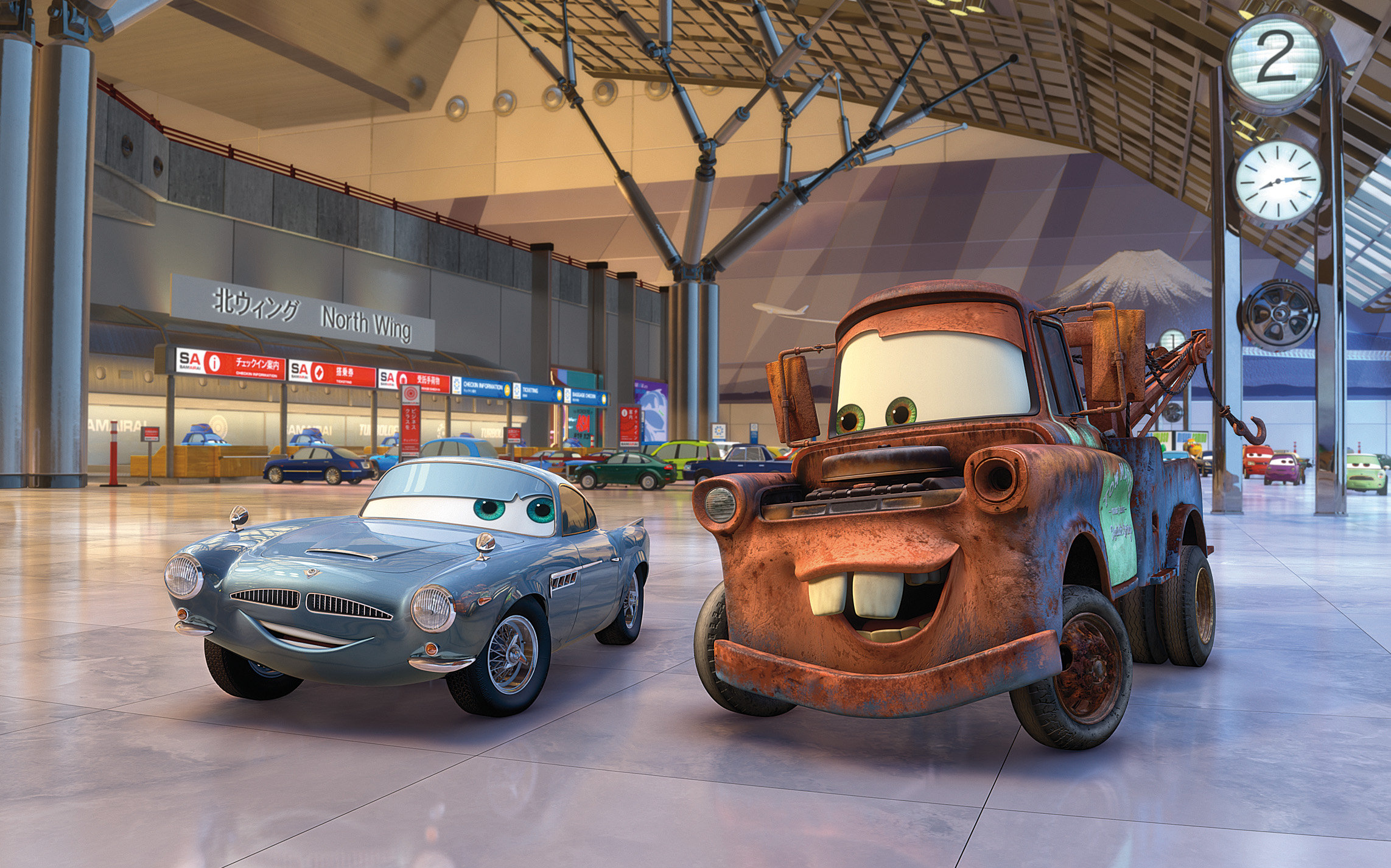 Mater (voiced by Larry the Cable Guy) meets the spy car Finn McMissile (voiced by Michael Caine) in Cars 2 (2011)