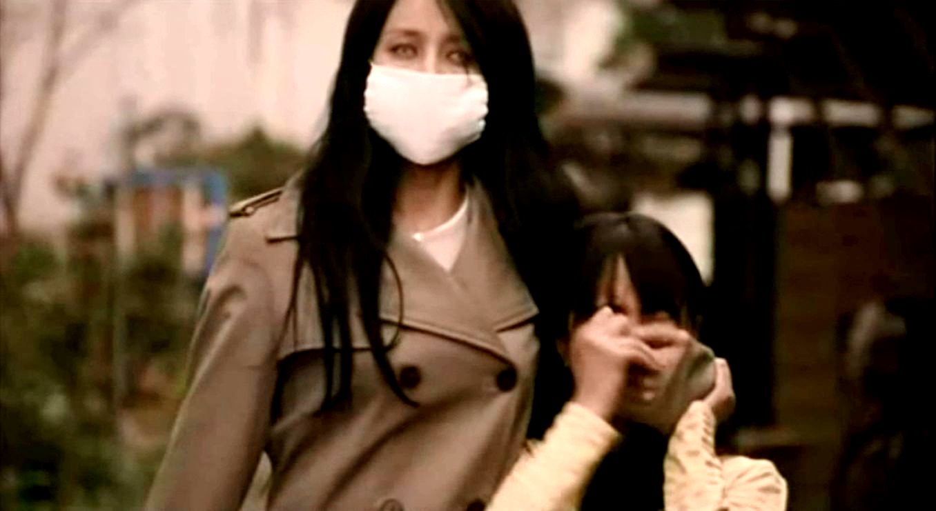The Kuchisake-onna (Miki Mizuno) in Carved: The Slit-Mouthed Woman (2007)