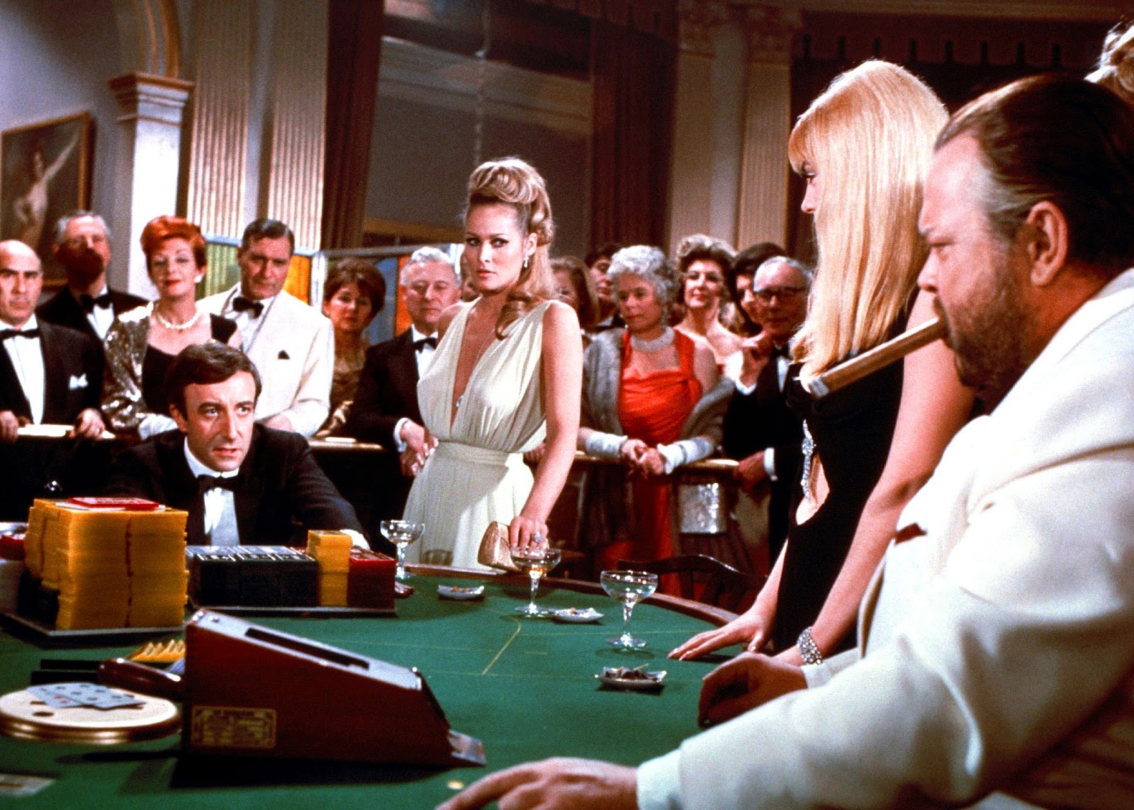 James Bond (Peter Sellers) faces down against Le Chiffre (Orson Welles) at the card table in the Casino Royale (1967)