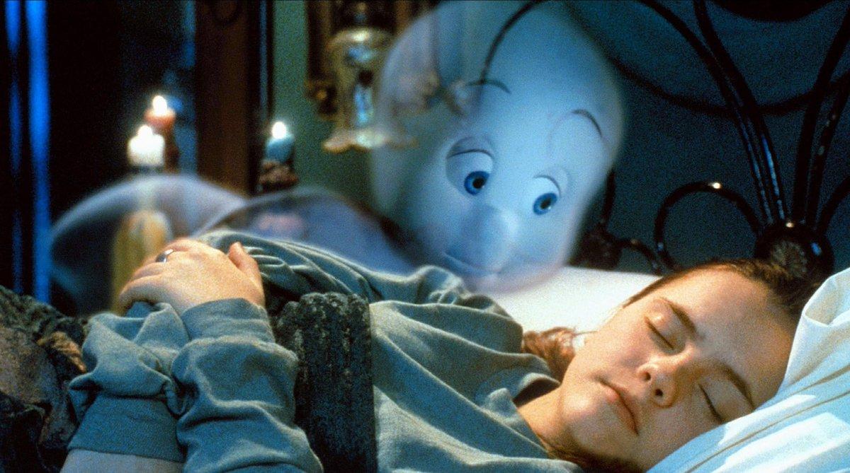 Casper looks over a sleeping Kat Harvey (Christina Ricci) in Casper (1995)
