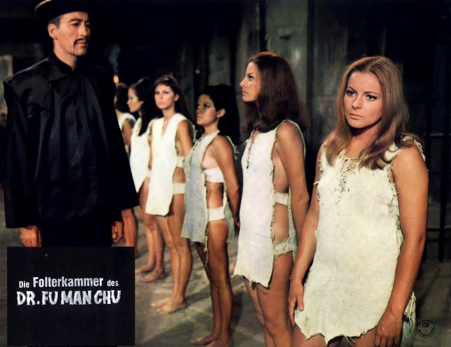Fu Manchu (Christopher Lee) surveys his collection of women in The Castle of Fu Manchu (1969)