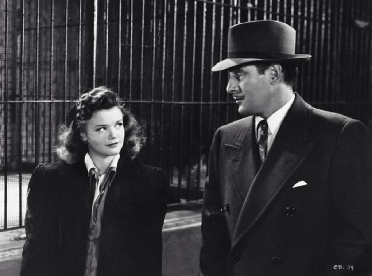Kent Smith (Tom Conway) meets Irena Dubrovna (Simone Simon) at the Central Park Zoo in Cat People (1942)