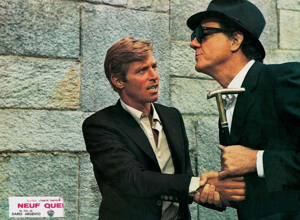 Journalist James Franciscus and blind crossword designer Karl Malden in The Cat O'Nine Tails (1971)