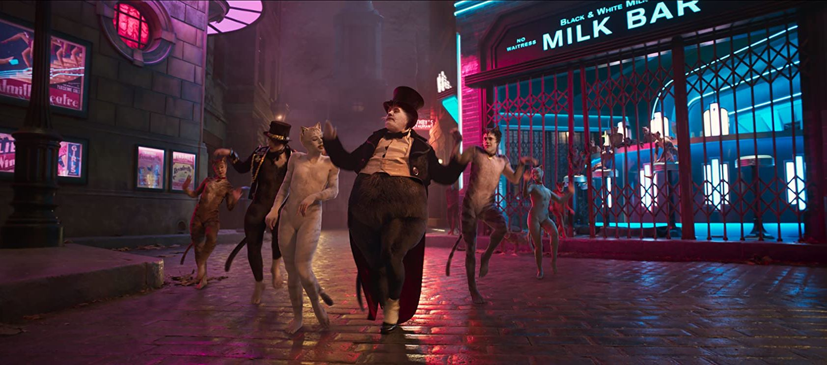 Bustopher Jones (James Corden) leads the Jellicle Cats in Cats (2019)