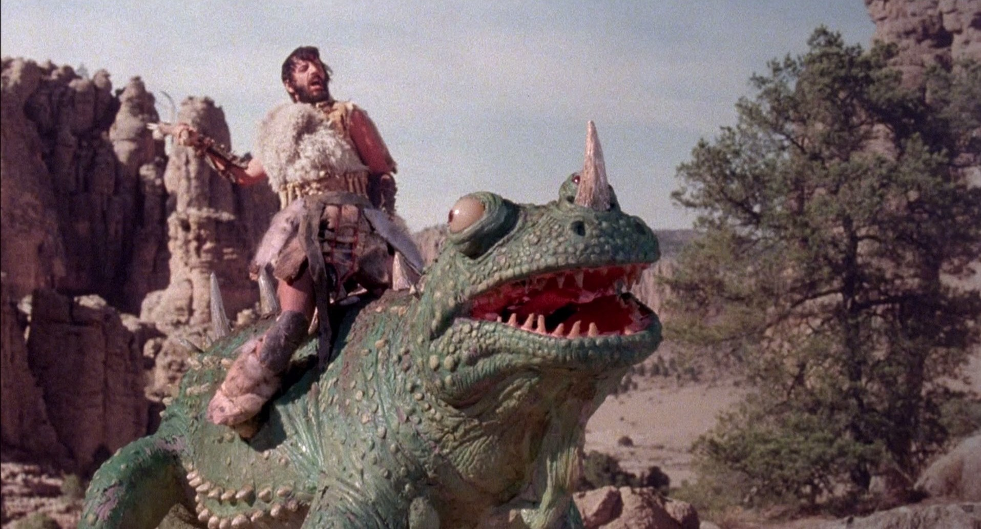 Ringo Starr on the back of a dinosaur in Caveman (1981)
