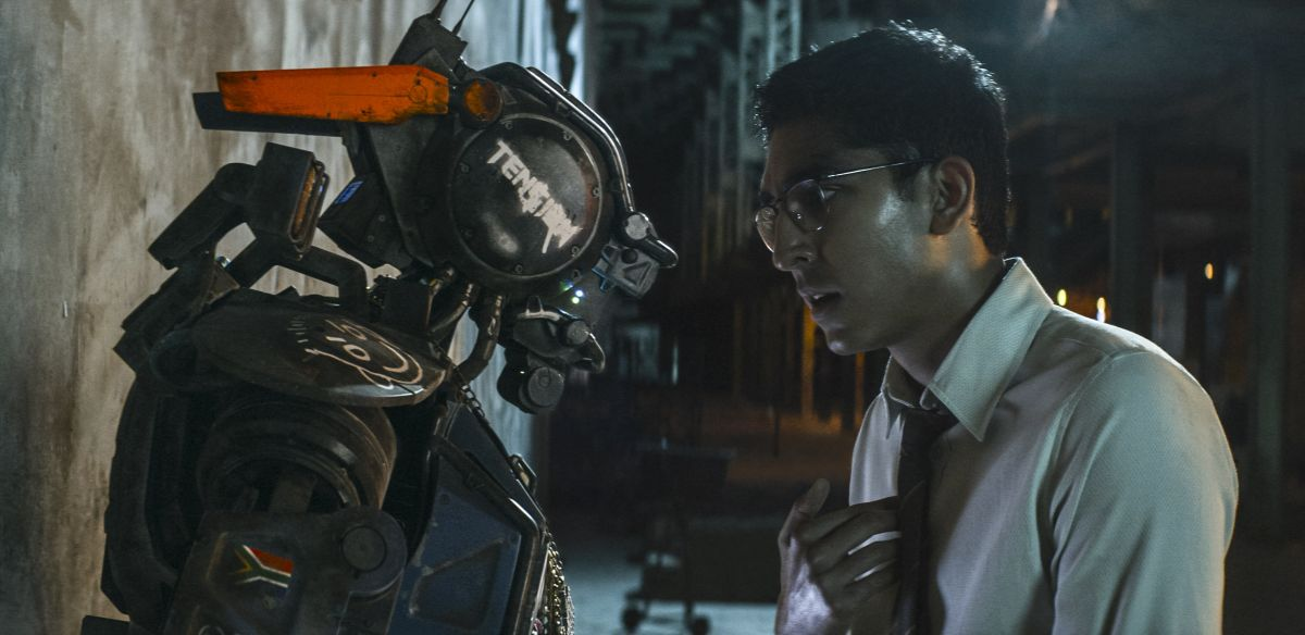 Chappie and creator Dev Patel in Chappie (2015)