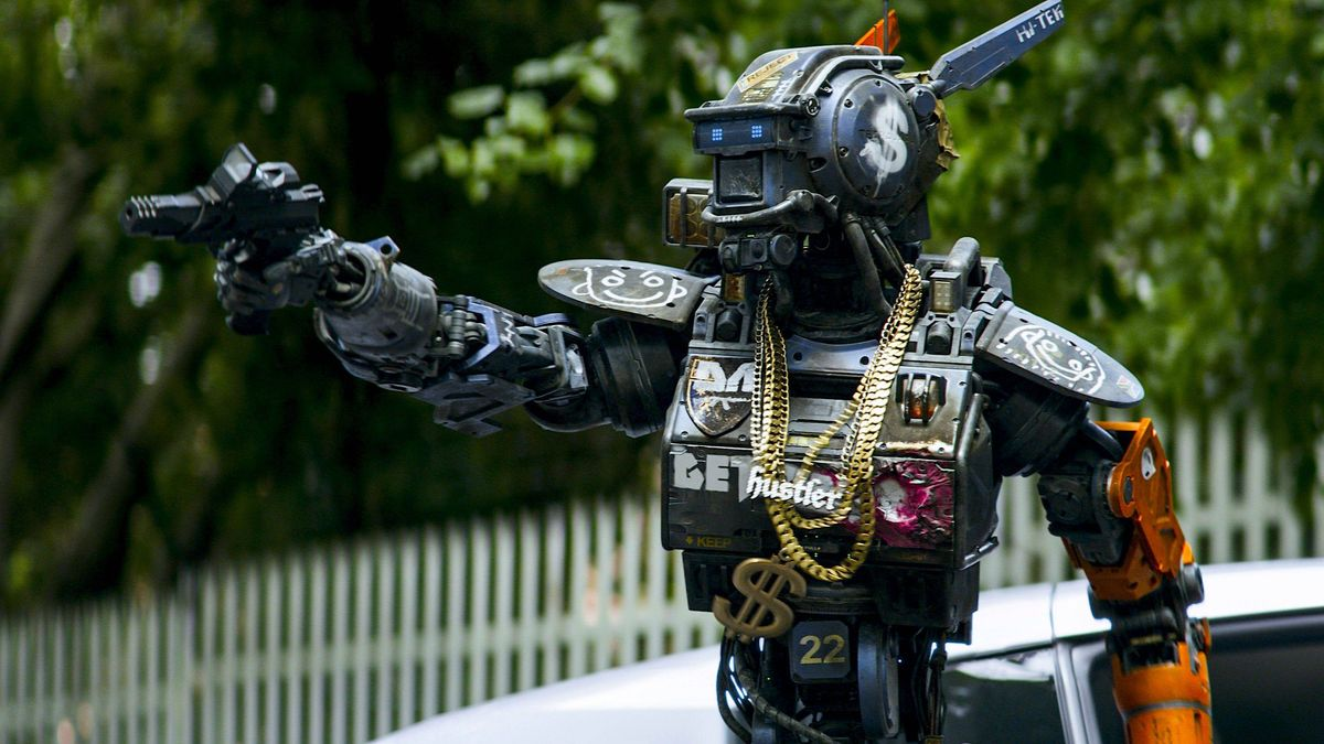 Chappie gets pimped out and goes car-jacking in Chappie (2015)