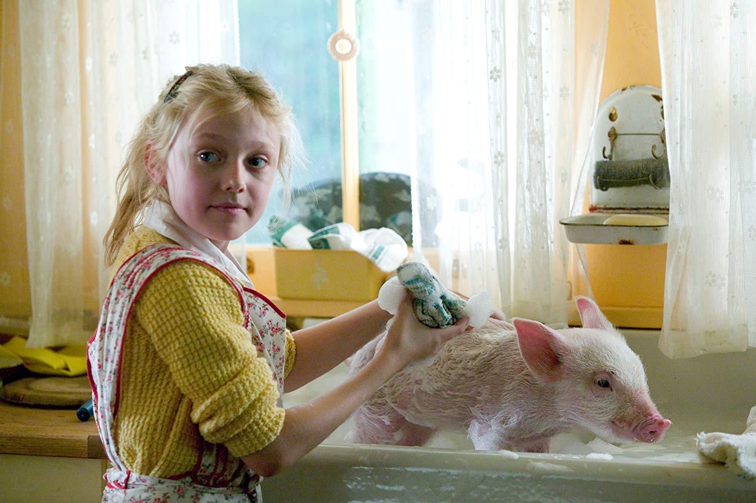 Fern Arable (Dakota Fanning) gives Wilbur a bath in Charlotte's Web (2006)