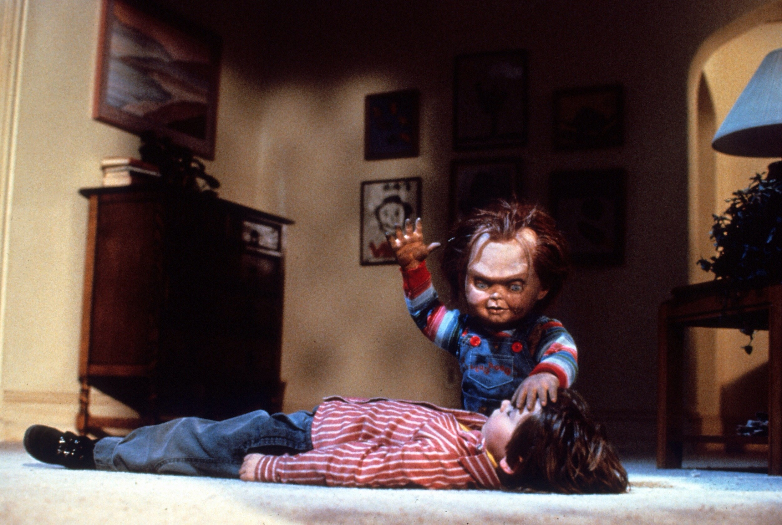 Chucky prepares to sacrifice Andy (Alex Vincent) in Child's Play (1988)