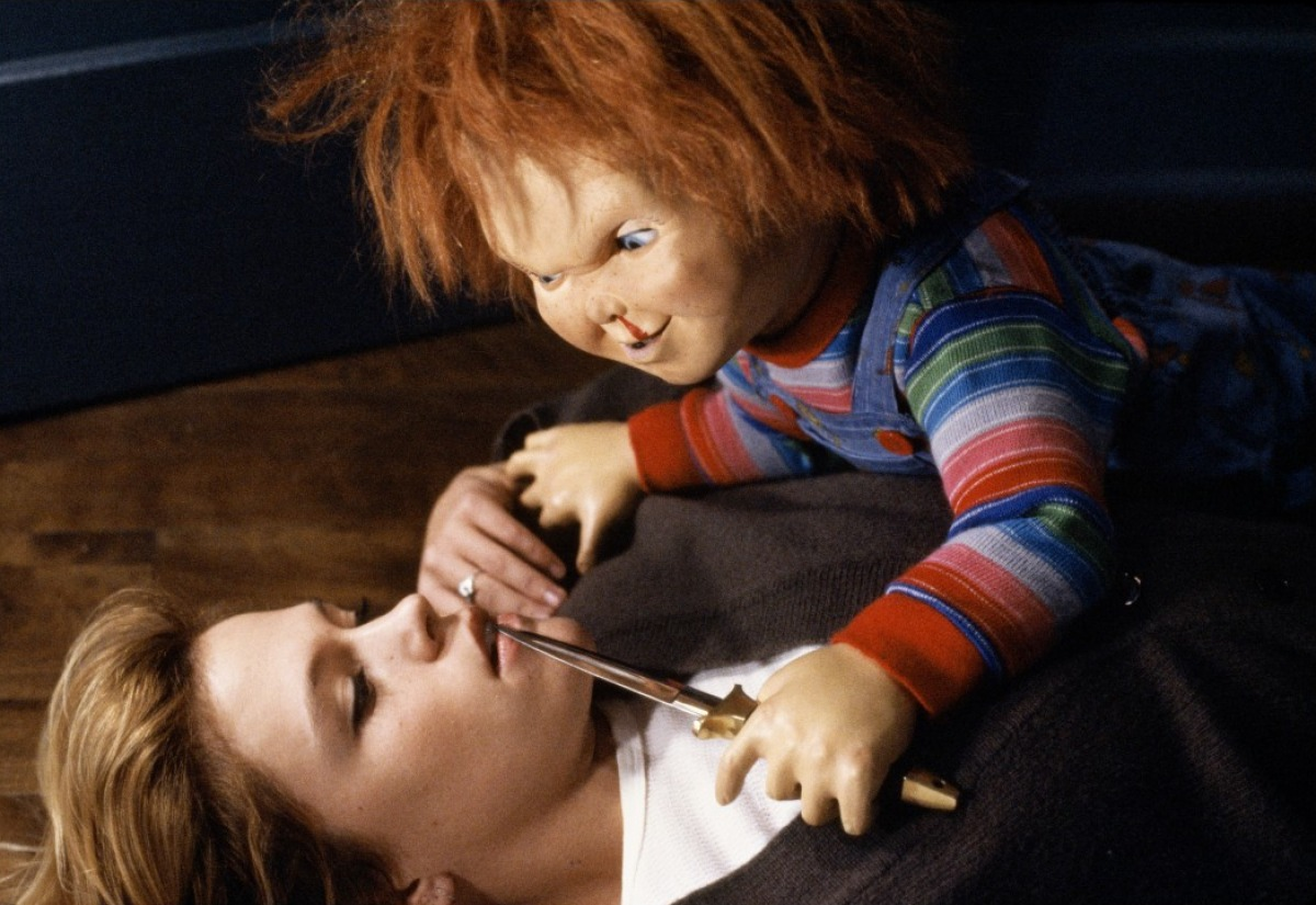 Chucky attacks Christine Elise in Child's Play 2 (1990)