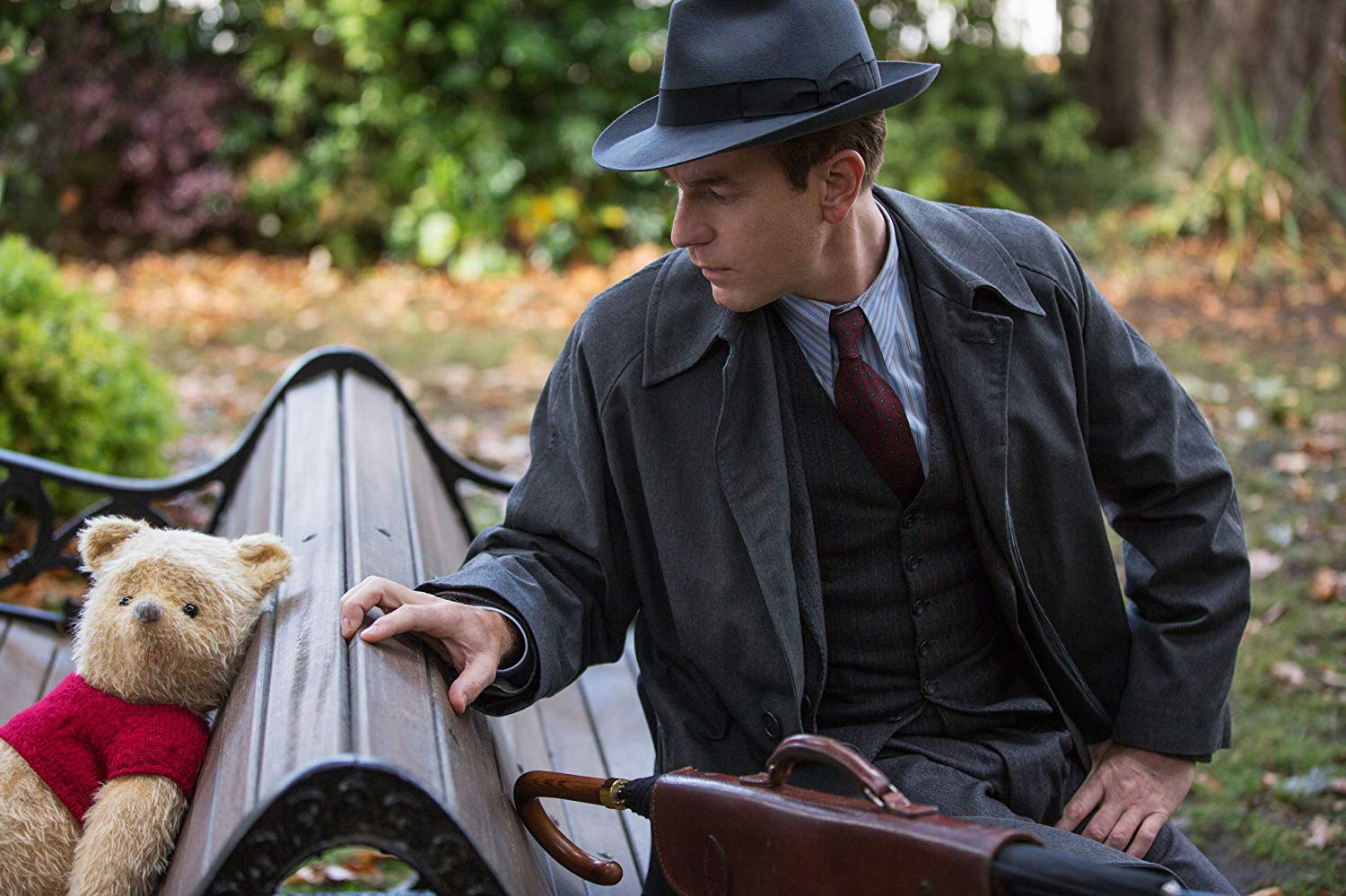 A grown-up Christopher Robin (Ewan McGregor) reconnects with Winnie the Pooh in Christopher Robin (2018)