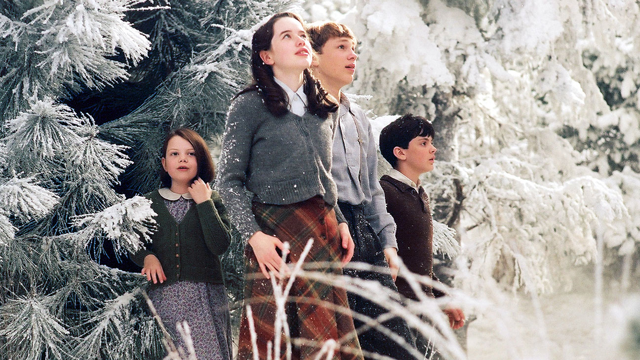 The Pevensie children emerge through the wardrobe into Narnia - (l to r) Lucy (Georgie Henley), Susan (Anna Popplewell), Peter (William Moseley) and Edmund (Skandar Keynes) in The Chronicles of Narnia: The Lion, The Witch and the Wardrobe (2005)