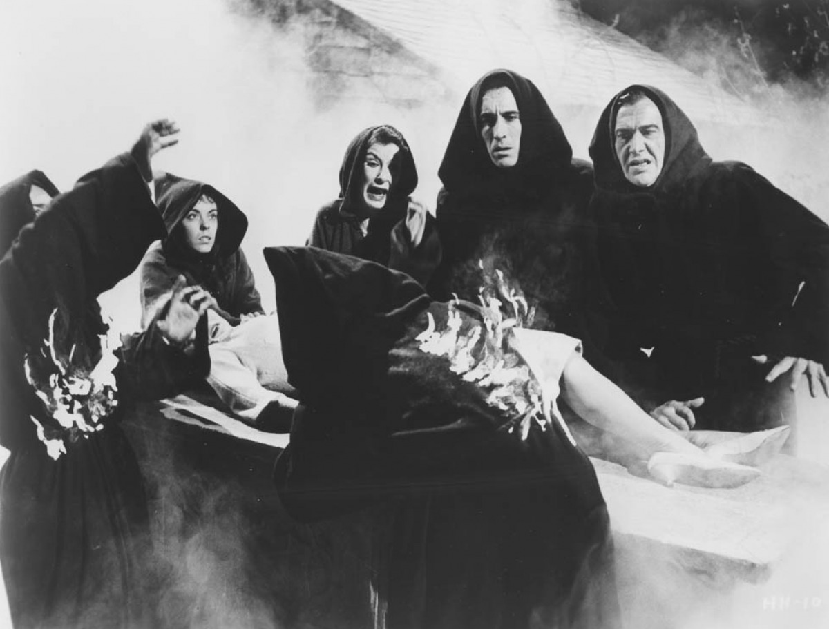 The town of witches with Christopher Lee (second from right) in City of the Dead (1959)