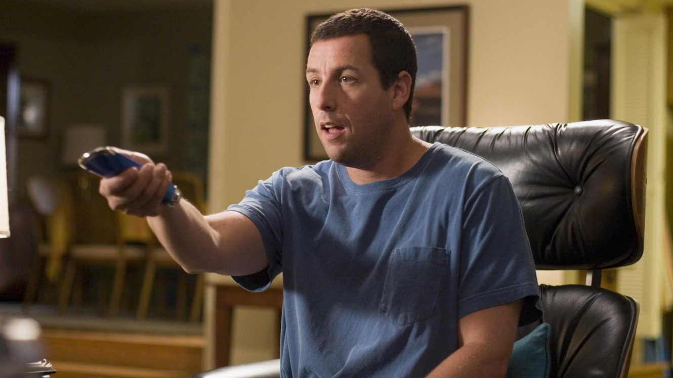 Adam Sandler with the remote control to life in Click (2006)