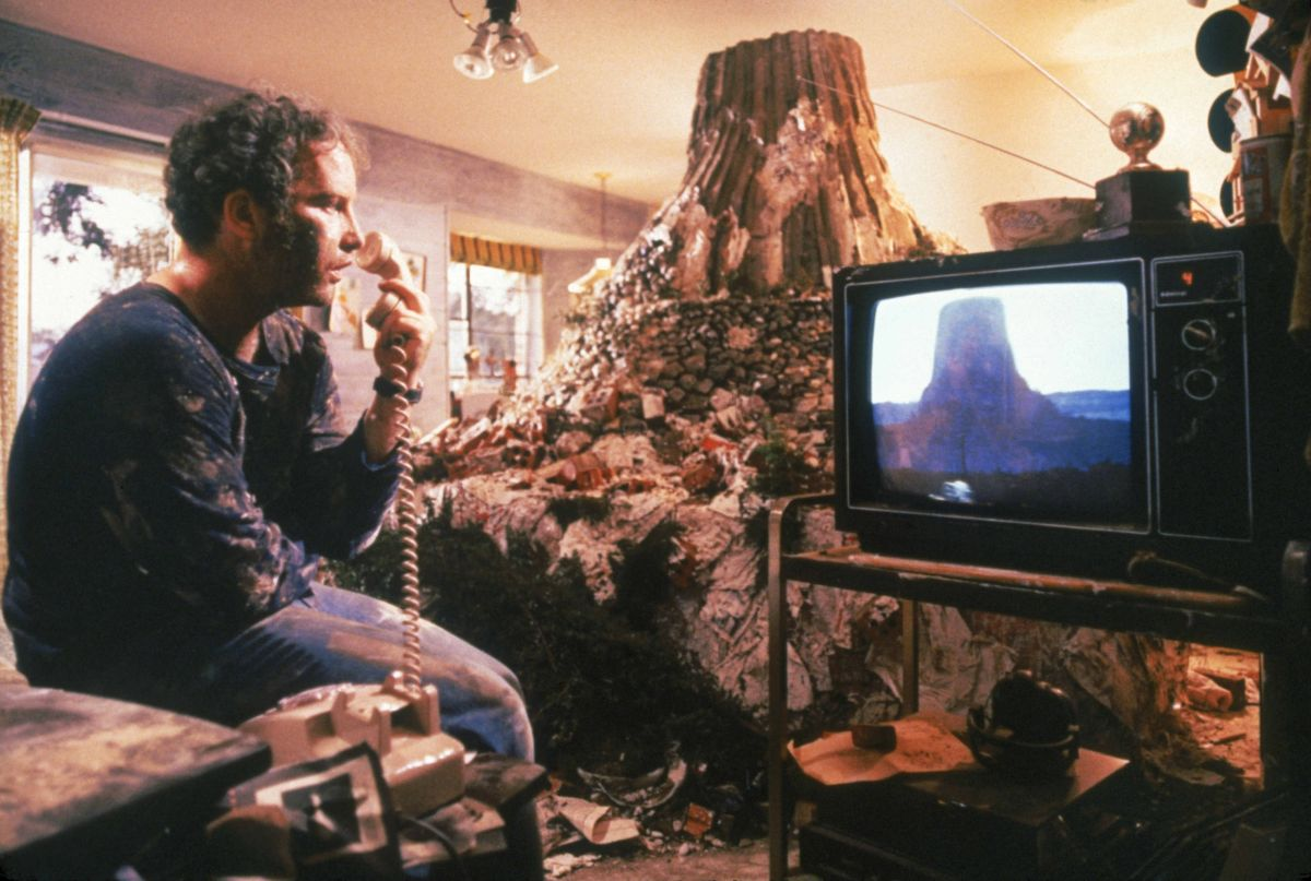 Richard Dreyfuss builds a model of Devil's Tower in his living room in Close Encounters of the Third Kind (1977)