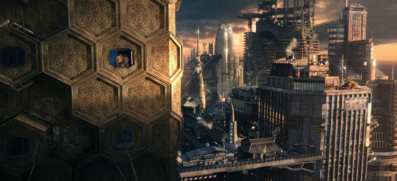 Soldier Hae-Joo Chang (Jim Sturgess) and fabricant Somni-451 (Doona Bae) make an escape through Neo-Seoul of 2441 in Cloud Atlas (2012)