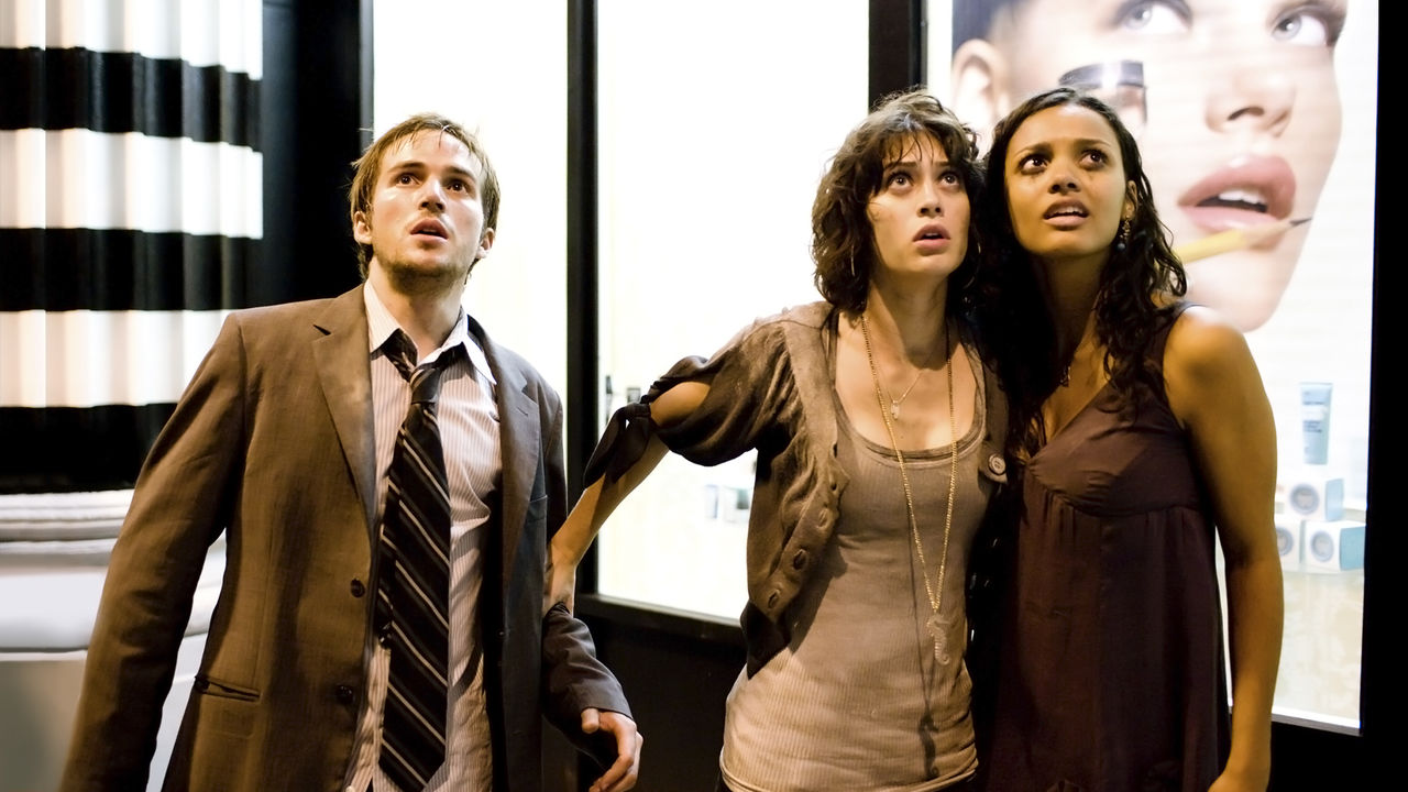 Michael Stahl-David, Lizzy Caplan and Jessica Lucas in Cloverfield (2008)