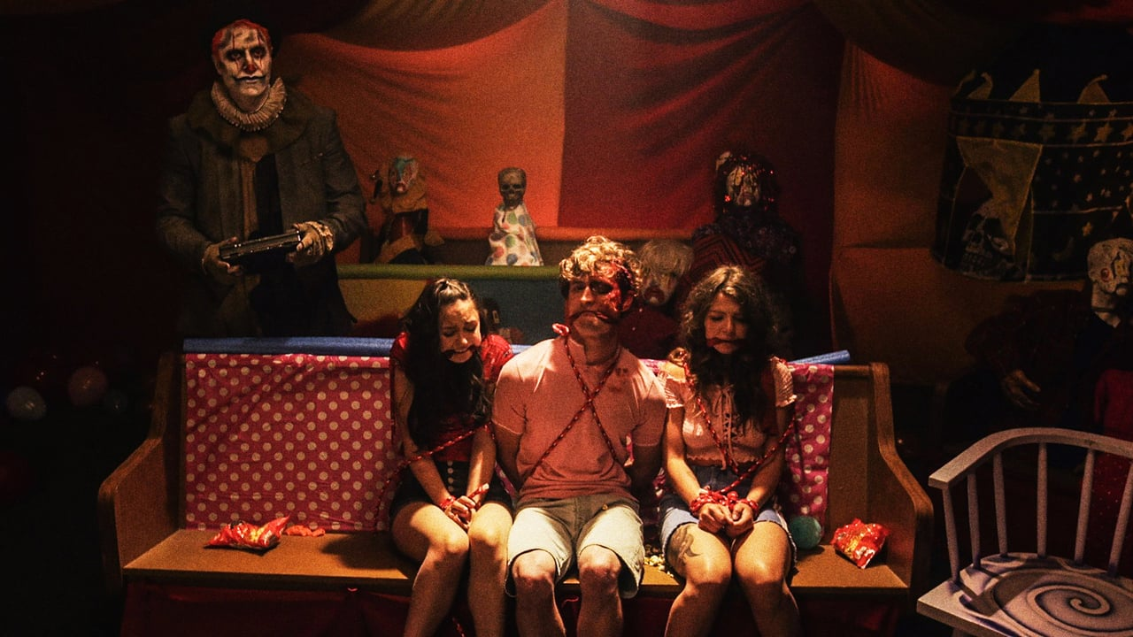 Thoth the Clown (Dave Klec) with an imprisoned Sally (Audrey Gibbs), Austin (Adam Elshar) and Sarah (Micavrie Amaia) in Clown (2019)