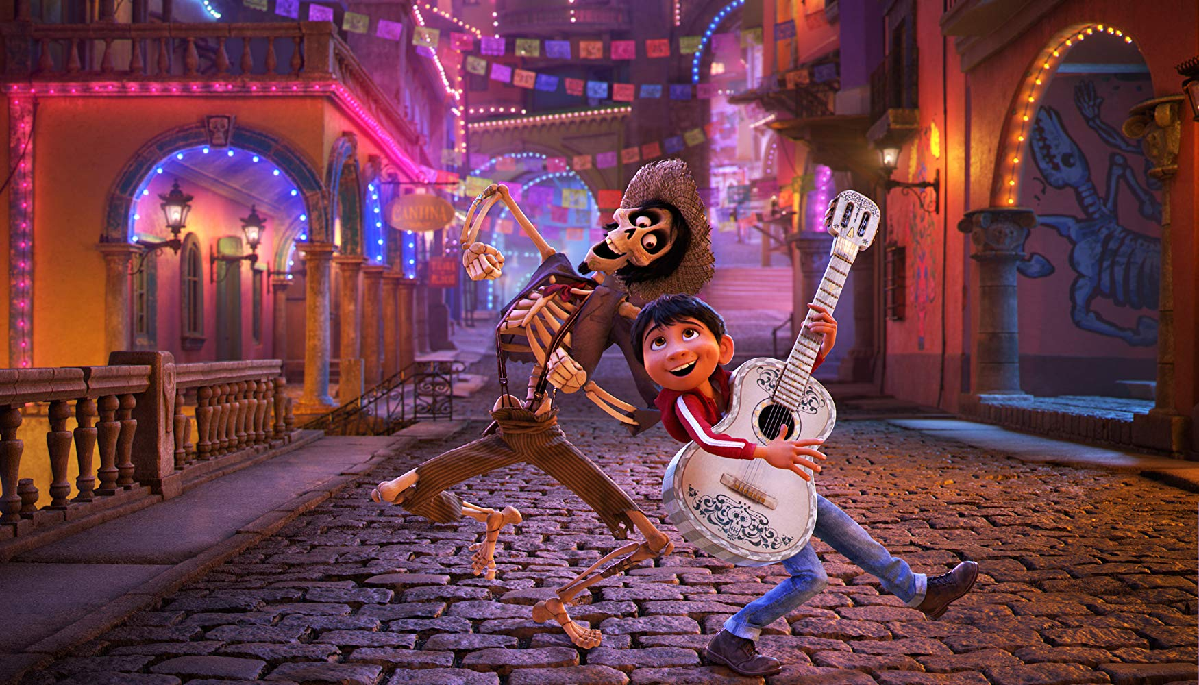 Hector (voiced by Gael Garcia Bernal) and Miguel (voiced by Anthony Gonzalez) sing through the streets in Coco (2017)
