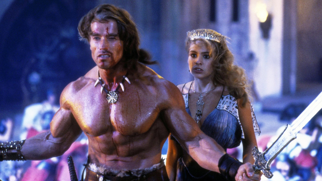 Conan (Arnold Schwarzenegger) assigned with protecting the Princess Jehnna (Olivia D'Abo) in Conan the Destroyer (1984)