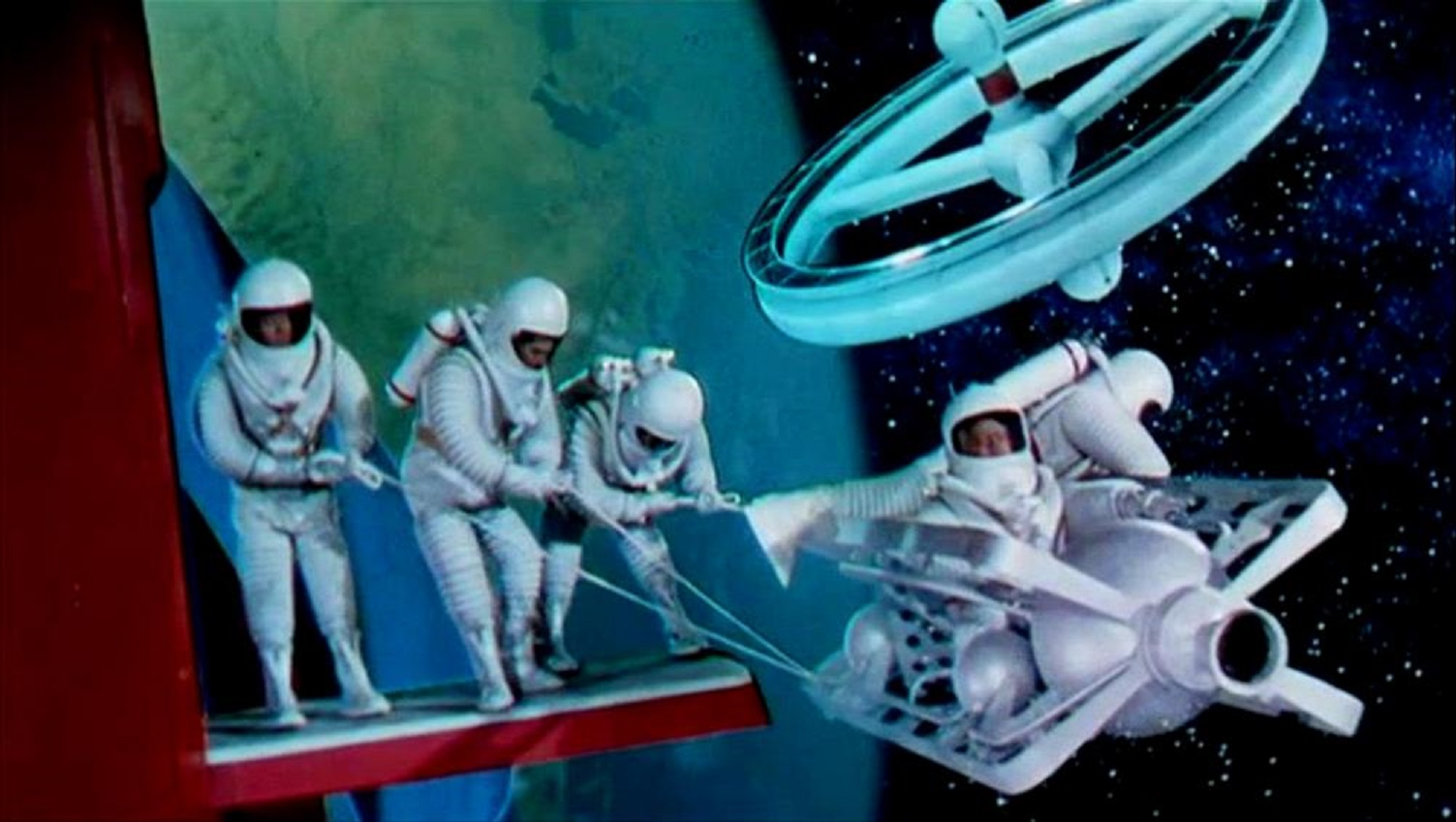 Astronauts using the space taxi in Conquest of Space (1955)