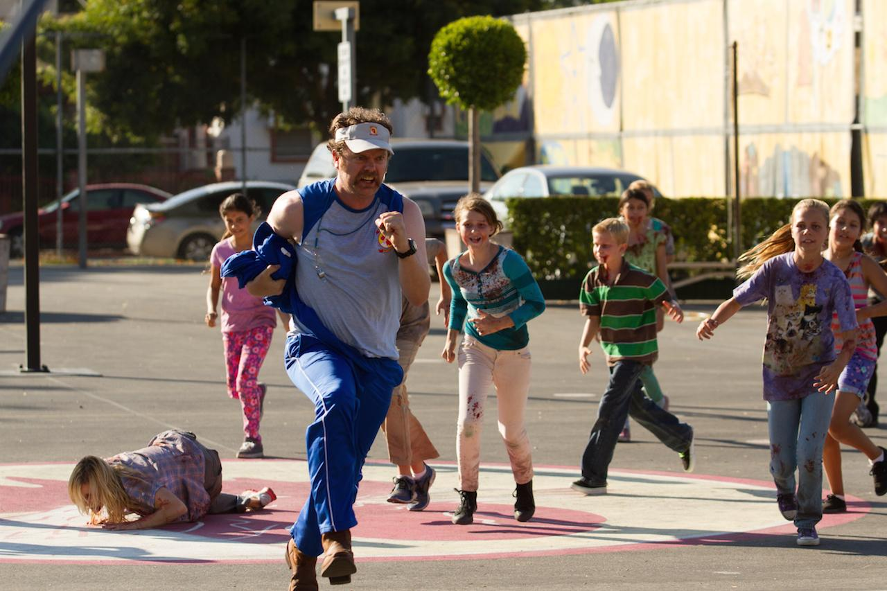 Rainn Wilson pursued by zombie children in Cooties (2014)