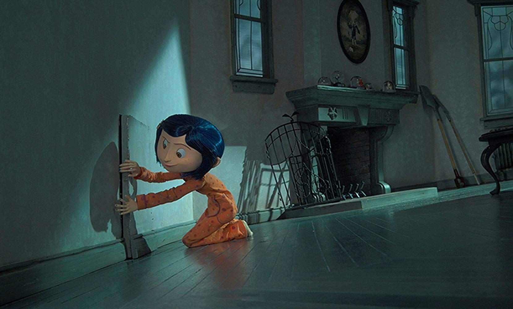 Coraline finds a mysterious door in the wall in Coraline (2009)