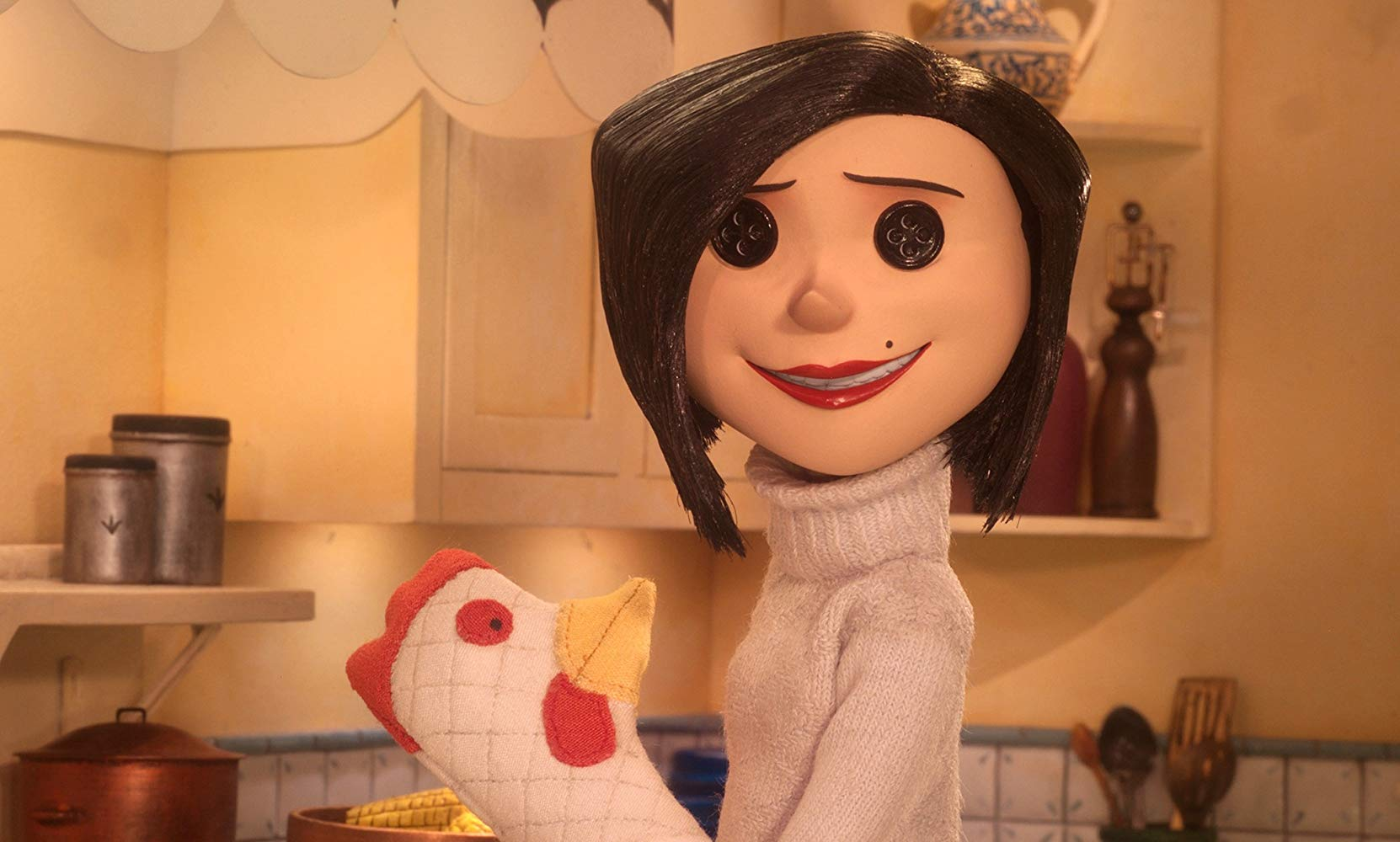 Coraline's mother with buttons for eyes in Coraline (2009)