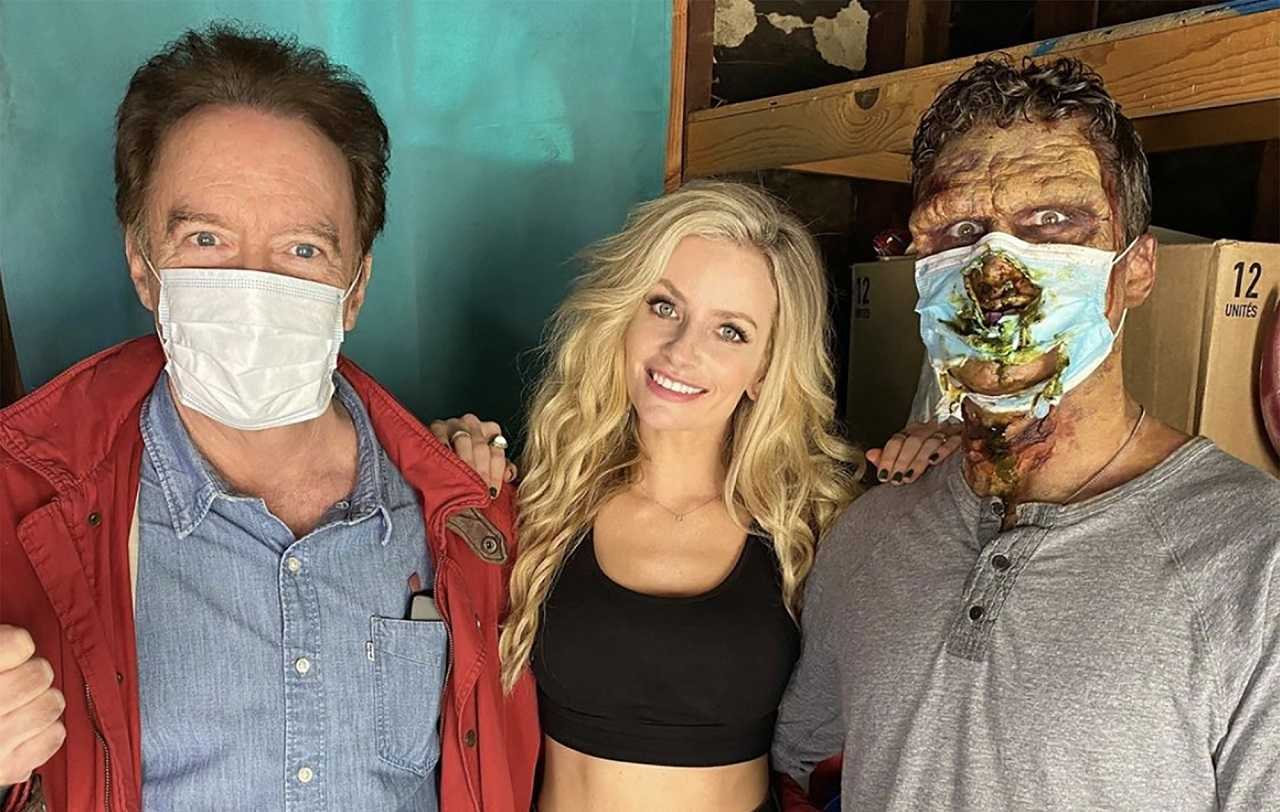 Director Charles Band, Barbie (Cody Renee Cameron) and the Corona Zombie (Russell Coker) in Corona Zombies (2020)